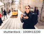 smiling young traveler woman in ... | Shutterstock . vector #1008413230