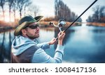 fisherman angling on the river. ... | Shutterstock . vector #1008417136