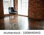chair stands near a window on...   Shutterstock . vector #1008440443