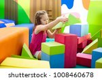 child playing with colorful... | Shutterstock . vector #1008460678