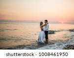lovers at sunset at sea | Shutterstock . vector #1008461950