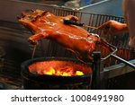barbecued suckling pig fire... | Shutterstock . vector #1008491980