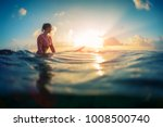 young lady surfer waits the... | Shutterstock . vector #1008500740