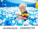 child playing in ball pit.... | Shutterstock . vector #1008500749