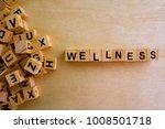 wellness word cube on wood...   Shutterstock . vector #1008501718
