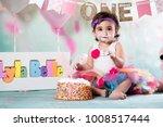baby girl cake smash | Shutterstock . vector #1008517444