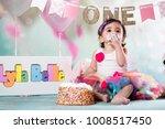 baby girl cake smash | Shutterstock . vector #1008517450