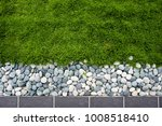 Top View Of Grass With Pebbles...