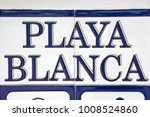 Small photo of A tiled Playa Blanca sign. Playa Blanca is the southernmost town of the Spanish island of Lanzarote.