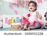 baby girl cake smash | Shutterstock . vector #1008531238