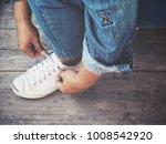 woman tying sneakers | Shutterstock . vector #1008542920