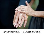 older couple displaying their... | Shutterstock . vector #1008550456
