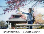 freedom traveler girl standing... | Shutterstock . vector #1008573544