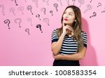 question marks with young woman ... | Shutterstock . vector #1008583354