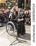 Small photo of New York, NY - January 20, 2018: Nadina LaSpina speaks at women's march in New York at Central Park West