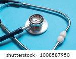 stethoscope on blue background. ... | Shutterstock . vector #1008587950