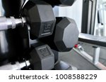 dumbbells on a rack with a... | Shutterstock . vector #1008588229