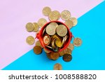 top view of gold coins on red... | Shutterstock . vector #1008588820