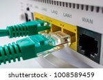 white router includes two green ... | Shutterstock . vector #1008589459