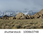sun on rocks and fog on sierra... | Shutterstock . vector #100863748