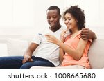 young balck couple happy about... | Shutterstock . vector #1008665680