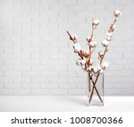 cotton flowers in vase on table | Shutterstock . vector #1008700366