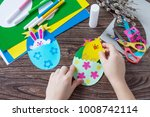 a child is holding an easter... | Shutterstock . vector #1008742114