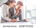 business people discussing in... | Shutterstock . vector #1008755320
