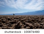 A Lone Man Stands In The...