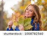 cute smiley girl holding leafs... | Shutterstock . vector #1008782560