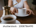 woman puts a cup of turkish... | Shutterstock . vector #1008786490