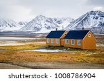 yellow houses on yellow tundra... | Shutterstock . vector #1008786904