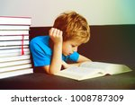 little boy reading books at... | Shutterstock . vector #1008787309
