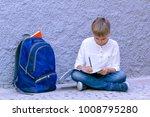 boy doing school homework. kid... | Shutterstock . vector #1008795280