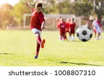 boy kicking football on the... | Shutterstock . vector #1008807310