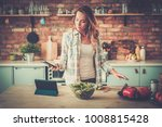 woman listening music while...   Shutterstock . vector #1008815428