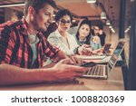 young colleagues discussing...   Shutterstock . vector #1008820369