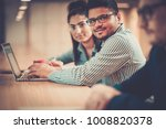 young specialists in coworking...   Shutterstock . vector #1008820378