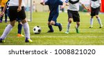 kids kicking soccer match. boys ... | Shutterstock . vector #1008821020