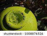 Green Water Fountain In Garden