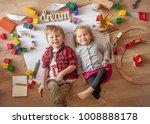 kids drawing on floor on paper. ... | Shutterstock . vector #1008888178