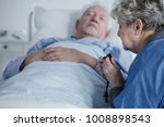 elderly woman praying with a... | Shutterstock . vector #1008898543