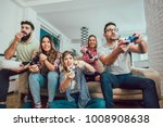 group of friends play video... | Shutterstock . vector #1008908638