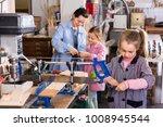 smiling  positive schoolgirls...   Shutterstock . vector #1008945544