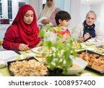 family gathering eating dinner... | Shutterstock . vector #1008957400