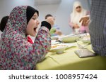 family gathering eating dinner... | Shutterstock . vector #1008957424