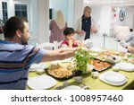 family gathering eating dinner... | Shutterstock . vector #1008957460