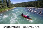 Aerial shot of a group paddling down the Nahanni River in Northwest Territories, Canada. - stock photo
