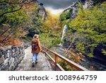 tourist woman in hat going to... | Shutterstock . vector #1008964759
