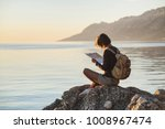 young traveler girl sitting... | Shutterstock . vector #1008967474